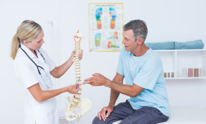Doctor and patient discussing spinal cord