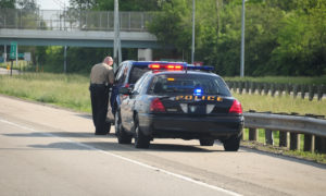 Police giving someone a Traffic Ticket for speeding in Lutz